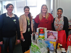 Pregnancy Outreach Worker Caroline (second from right) with Asda's Community Life Champion Judah (right) and other Asda staff