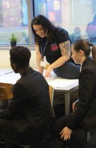 Peer Educator Cherelle with pupils at Grace Academy